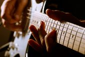 foto of guitar  - Hands of man playing electric guitar. Low key photo.