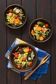 foto of sweet-corn  - Overhead shot of three rustic bowls of baked vegetables  - JPG