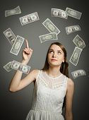 pic of lottery winners  - Girl in white and falling dollar banknotes - JPG