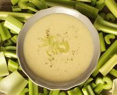 image of vegetable soup  - Top view of a celery soup surrounded with fresh vegetables - JPG