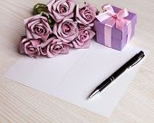 image of purple rose  - blank card with a pen - JPG