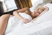 pic of laying-in-bed  - Pretty young woman laying on the bed