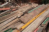 stock photo of timber  - Pile of raw timber and iron for recycling at waste depot - JPG