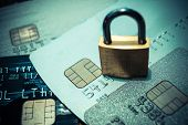 pic of lock  - a security lock on credit cards  - JPG