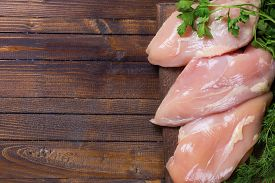 image of turkey-hen  - Fresh chicken meat with herb on wooden board on table  - JPG
