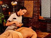picture of panchakarma  - Man  having pouring oil Ayurveda spa treatment with window - JPG