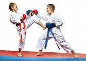 picture of karate  - Paired exercises karate in performing athletes in karategi - JPG