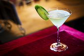 pic of curacao  - blue curacao lime and cucmber martini in bar at night - JPG