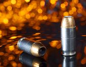 image of hollow  - Ammunition designed for a pistol that has a hollow pointed bullet with an orange background - JPG