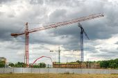 image of construction crane  - Construction site with cranes - JPG