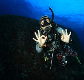stock photo of cave woman  - Young woman scuba diving - JPG