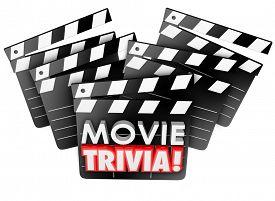 stock photo of quiz  - Movie Trivia words on film studio clapper boards to illustrate a cinema quiz - JPG
