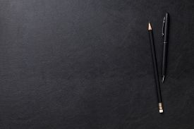 picture of pencils  - Office leather desk table with pen and pencil - JPG