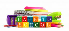 pic of colore  - Colorful Back to School wooden toy blocks with group of school supplies over white background - JPG