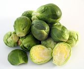 picture of brussels sprouts  - A pile of brussels sprouts with a sliced sprout in the foreground - JPG