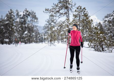 Crosscountry skiing young woman crosscountry