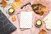 Flat Lay Composition With Books, Candles And Autumn Leaves On Fuzzy Rug poster