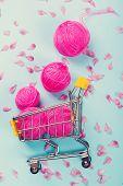 Bright Pink Wool Balls. Shopping Cart Full Of Yarn. Soft Cotton Wool Balls And Pink Petals. Flat Lay poster