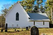 image of funeral home  - Church in a cemetery with tombstones and blue sky - JPG