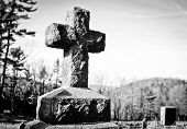 picture of funeral home  - Black and white cross in a graveyard - JPG