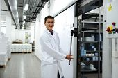 picture of factory-worker  - Industrial modern refrigerator - JPG