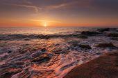 Seascape During Sunrise. Beautiful Natural Seascape, Blue Hour. Sea Sunrise At A Black Coast Near Va poster