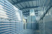 Interior Of A Modern Warehouse In The Blue Toned Packing Of Bottles In The Warehouse Of The Glass Fa poster