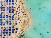 Amazing Aerial View From Above Over Nissi Beach In Cyprus. Nissi Beach At High Tide. Tourists Relax  poster