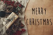 Merry Christmas Text Sign On Stylish Rustic Christmas Gift Box With Fir Branches, Red Berries, Pine  poster