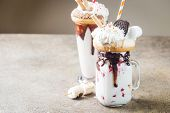 Milk Monster Shakes Or Freak Shake. Big Crazy Milkshake Or Freakshake With Treats And Sweets Mix. Sw poster