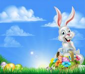 White Easter Bunny With A Basket Full Of Decorated Chocolate Easter Eggs In A Field Easter Backgroun poster