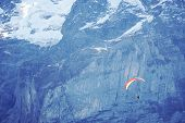 Skydiver Soaring Flight In The Sky In Sunny Day On The Mountain And Snow Background.extreme Sport Ac poster