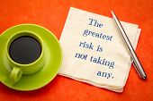 The greatest risk is not taking any - handwriting on a napkin with a cup of coffee poster