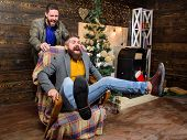 Break Into New Year With Fun. Best Friend Having Fun On Christmas Eve. Man Push Armchair With Friend poster