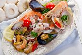 foto of norway lobster  - sea salad on dish - JPG