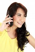 stock photo of handphone  - happy teenager girl talking at the handphone - JPG