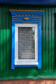 foto of woodcarving  - Decoration of a window new plastic frame and woodcarving - JPG