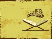 stock photo of islamic religious holy book  - Arabic Islamic calligraphy of text Ramadan Kareem with open Islamic religious holy book Quran Shareef on grungy vintage background - JPG