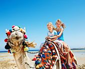 picture of hump  - Tourists children riding camel  on the beach of  Egypt - JPG