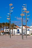 View Of Town Square With Modern Lamps. Manta Rota, Portugal