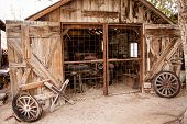 stock photo of yesteryear  - A vintage wooden auto garage in a rural setting - JPG