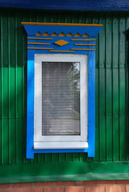 image of woodcarving  - Decoration of a window new plastic frame and woodcarving - JPG