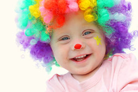 picture of clowns  - A cute smiling baby boy is dressed up in a clown wig with clown make up face paint - JPG