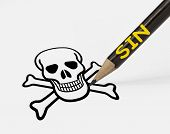 stock photo of forgiven  - concept of sin leading to death with pencil drawing skull - JPG