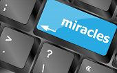 pic of qwerty  - Computer keyboard key button with miracles text - JPG