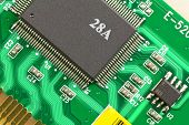 stock photo of microprocessor  - Large and small microprocessor components on the circuit board green - JPG