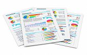 stock photo of graph paper  - Stack of paper documents with financial reports with color bar graphs pie charts and statistic information data isolated on white background - JPG