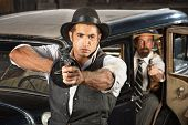 picture of tommy-gun  - Tough 1920s vintage gangsters by car with weapons - JPG