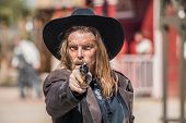 image of foursome  - Cowboy Points Gun at You in Town - JPG
