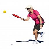 picture of pickleball  - Isolated digital image of a senior woman hitting the pickleball during a pickleball match - JPG